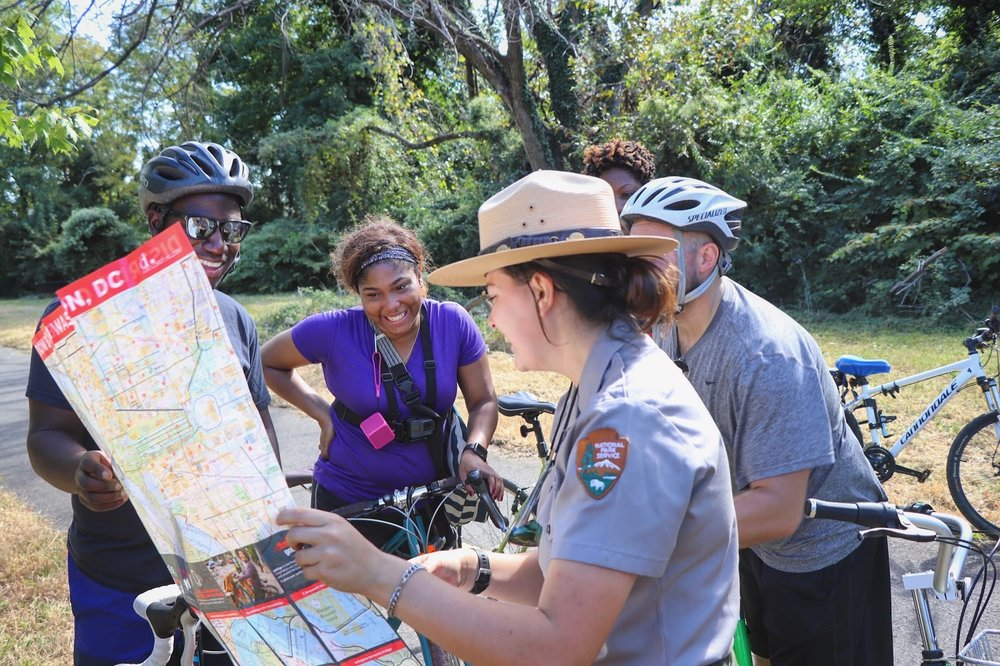 Park ranger provides directions to visitors on the Anacostia Riverwalk Trail. (NPS Photo)