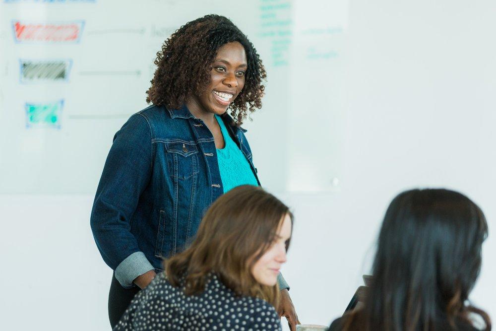 Black woman leading meeting/training.