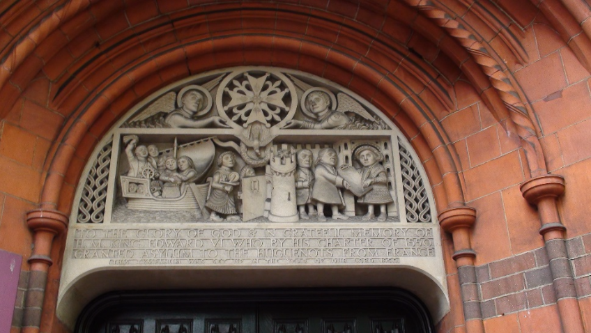 Sculpture above doorway the only remaining French Protestant Church in London, first established by royal charter in 1550 it now occupies  by Aston Webb erected between 1891–93 in Soho Square.