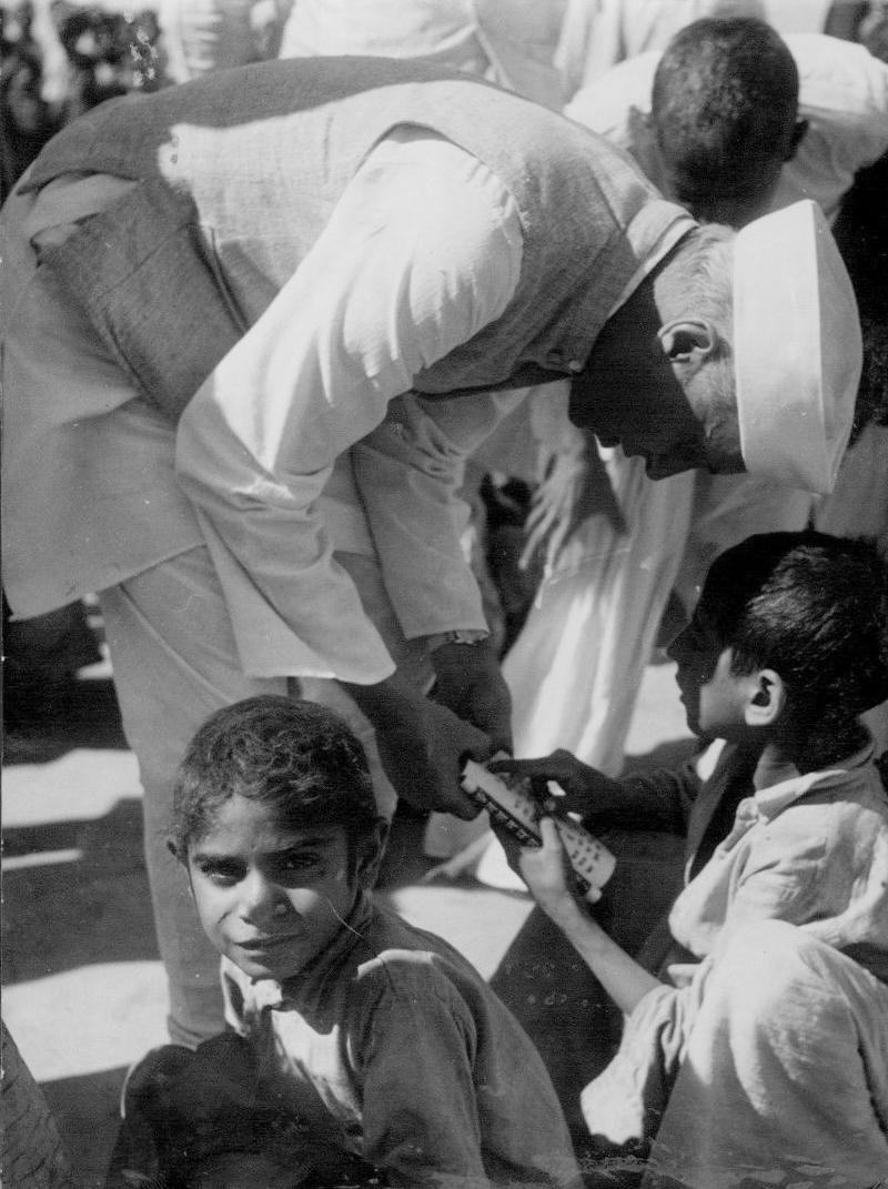 Nehru with refugee children in the Kurukshetra refugee camp.