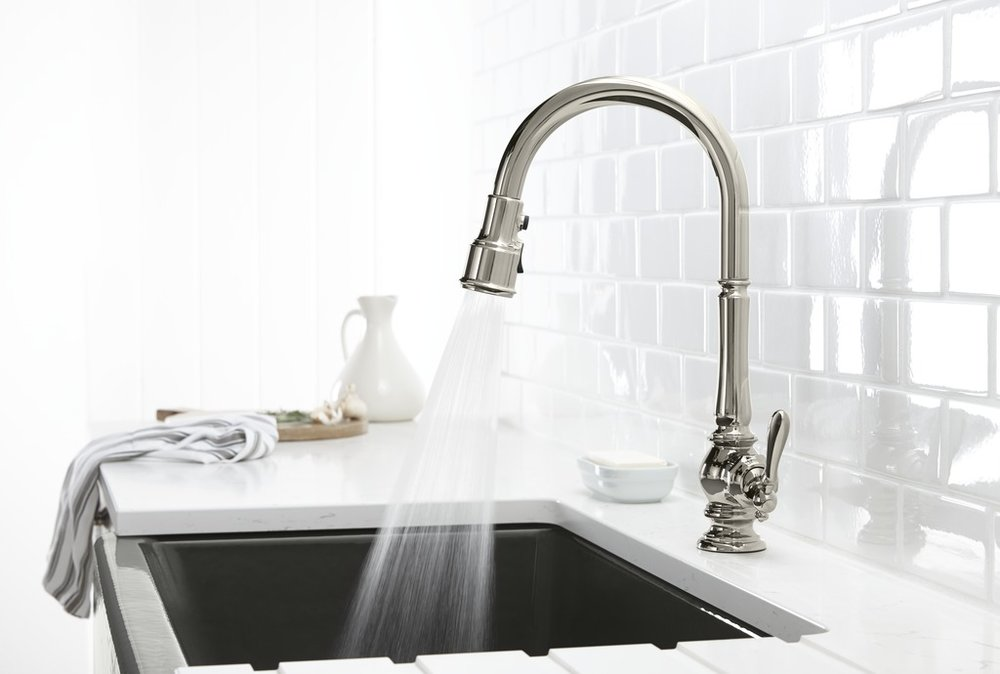 kitchen sink faucet spraying water