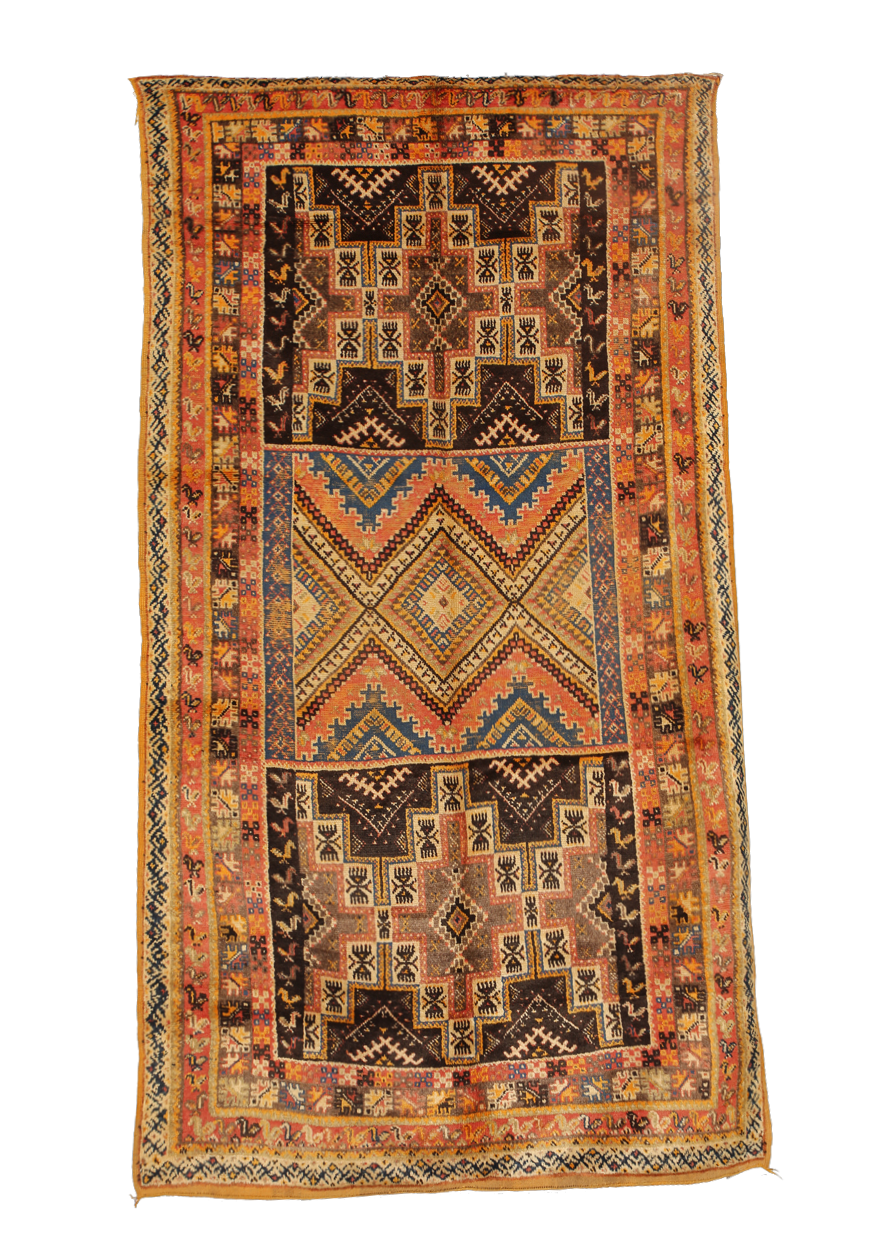 TAZNAKHT CARPETS   These carpets usually come in red and saffron-yellow hues from the area 140 km from Ouarzazate. The combination of the rug's colors and esoteric symbolism gives this piece of ethnic art its unique appeal.