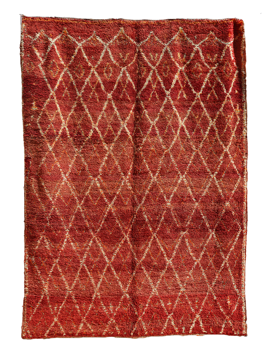 ZEMM  OUR CARPETS    Zemmour tribes produce a less thick pile using a series of differing designs, both horizontal and vertical. Zemmour carpets are mostly built on a dark reddish background.