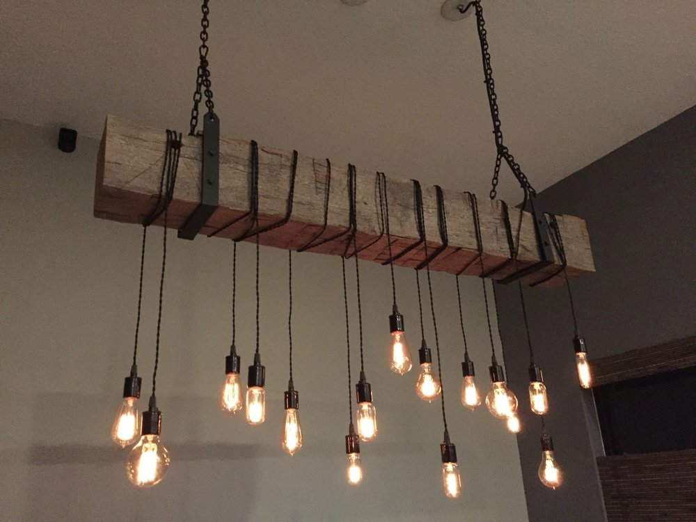 Barn Beam Fixture with Wrapped Lights and Metal Brackets