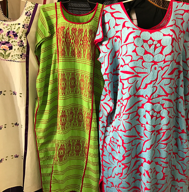 Traditional embroidered tunics sold at the market