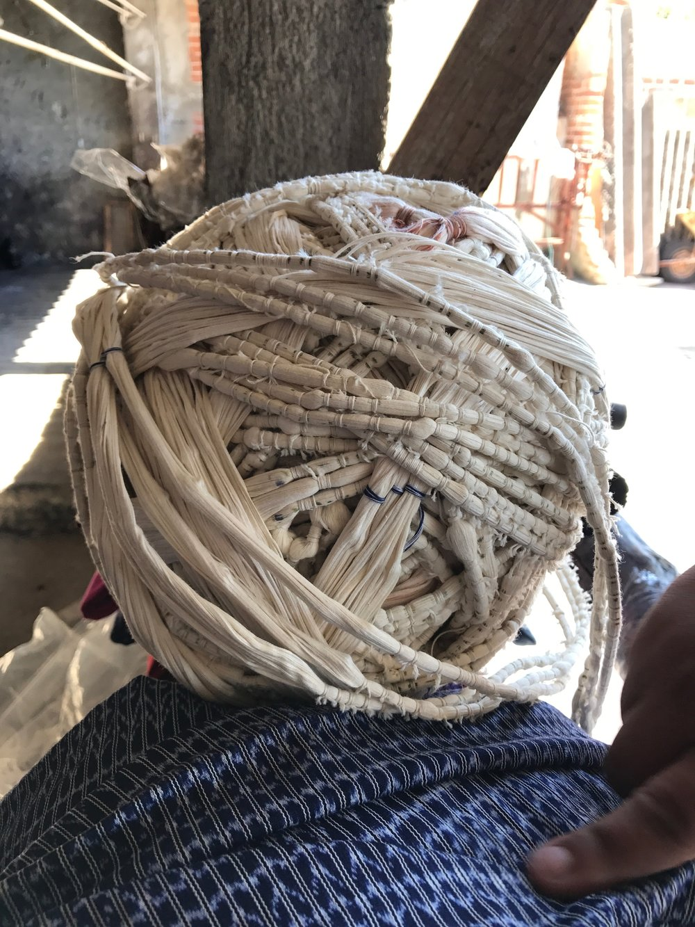 White threads with knots