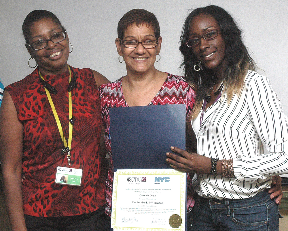 Candida O. receiving her certificate