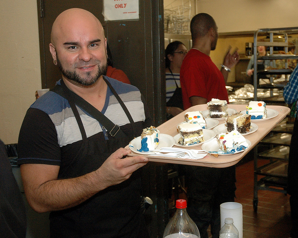 Rudolfo Chacin serving dessert to the attendees
