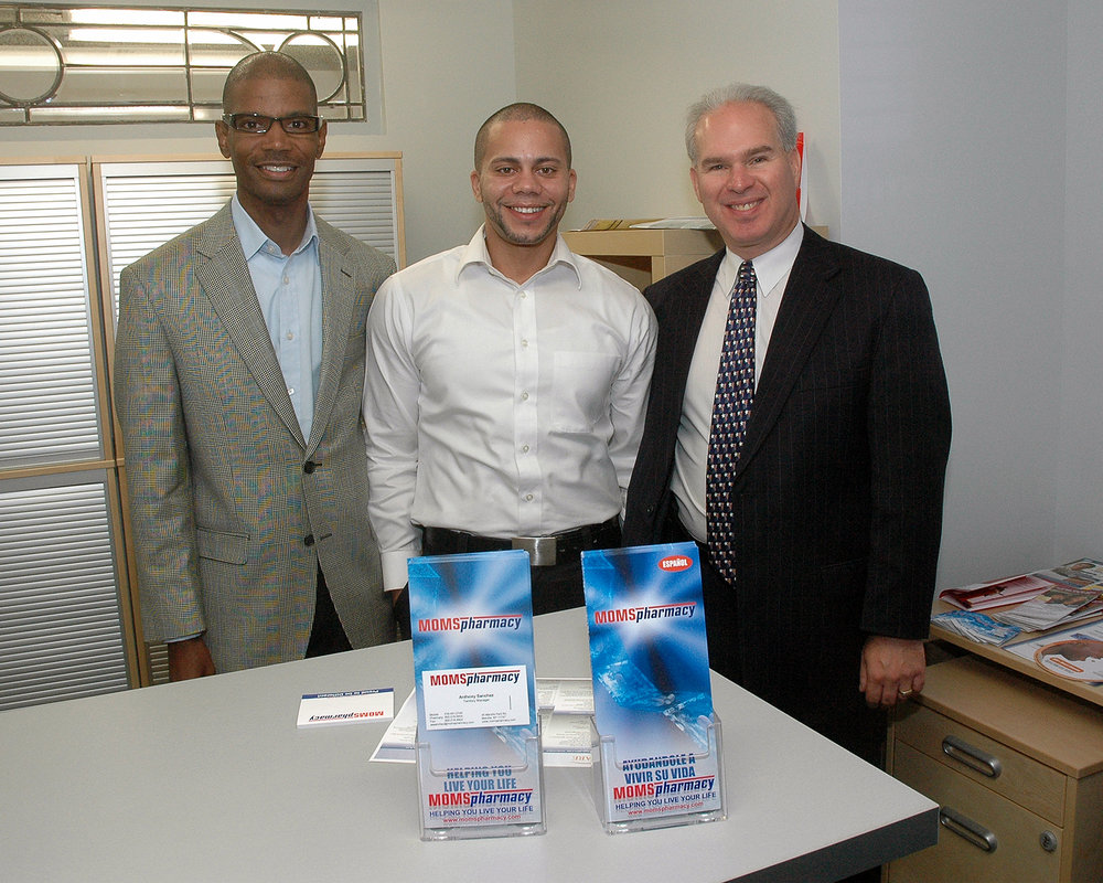 Glenn Schabel, MOMS Pharmacy with two representatives from MOMS Pharmacy