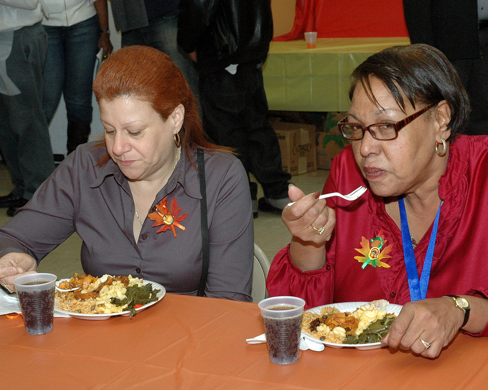 Two attendees enjoying their meal