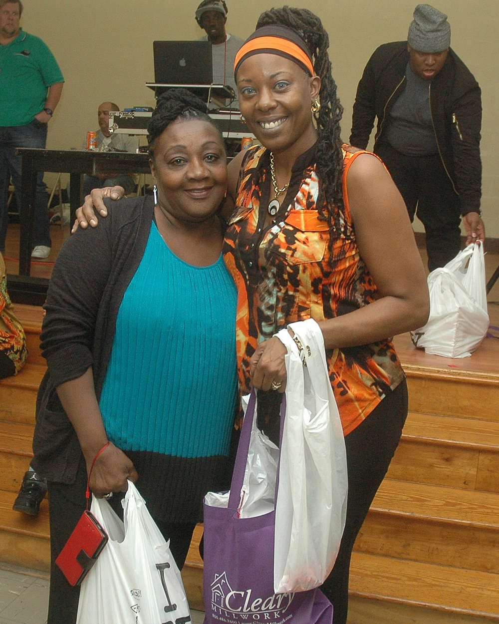A happy raffle winner with Vanessa Sullivan