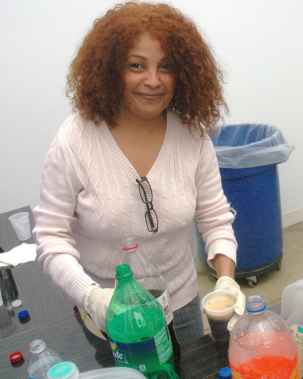 Velia Hernandez at the beverage station