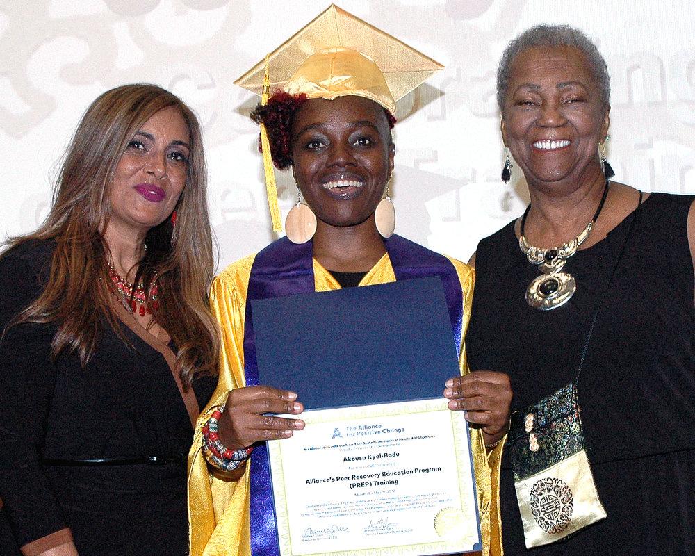 Akousa K. receiving her certificate