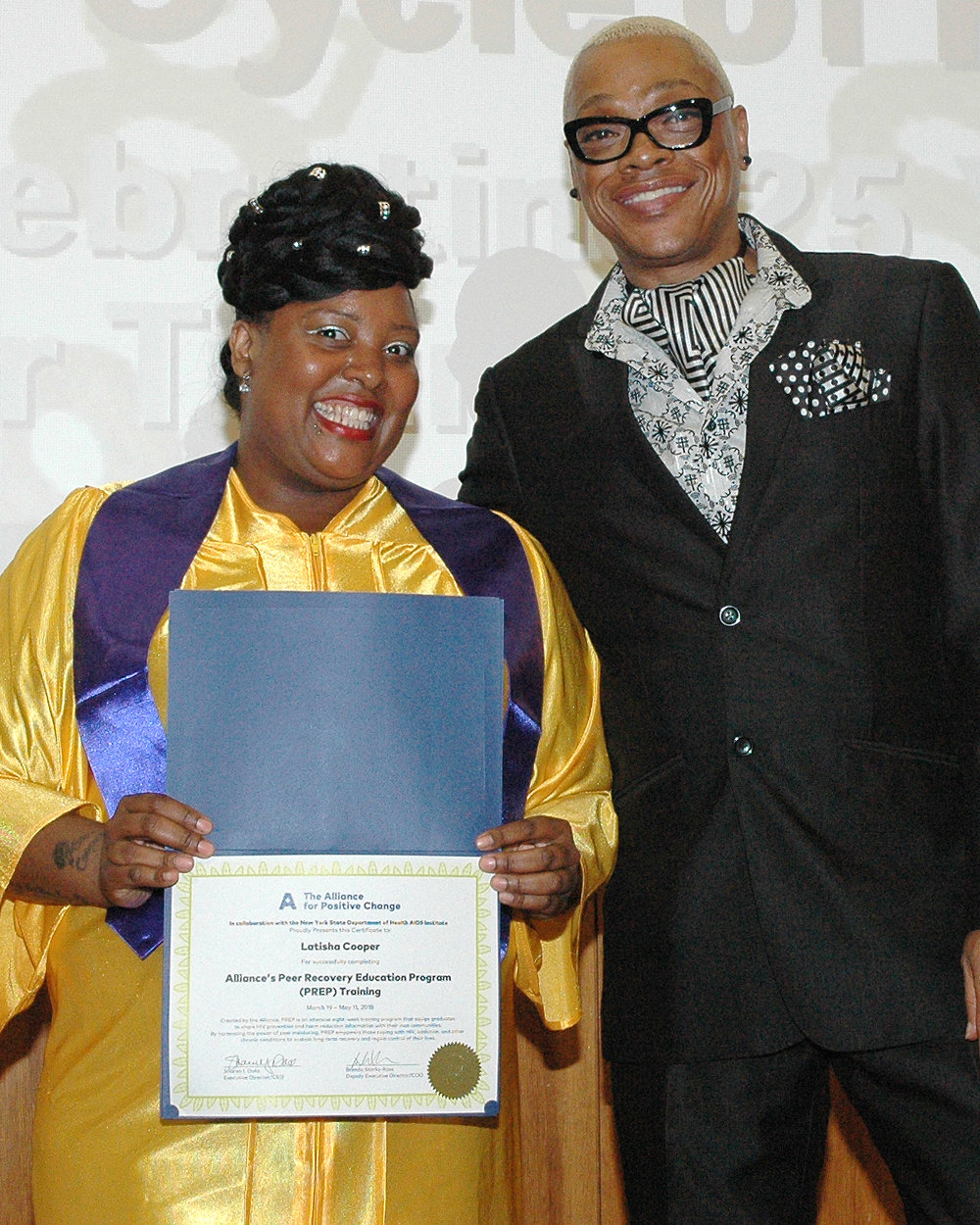 Latisha C. receiving her certificate