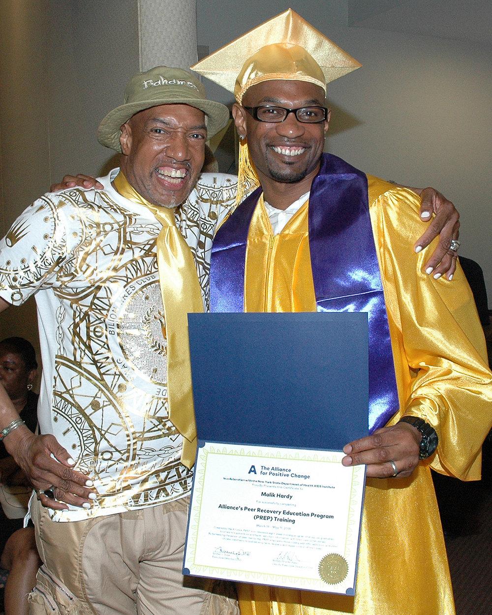 Thomas P. and Malik H. with Malik's certificate