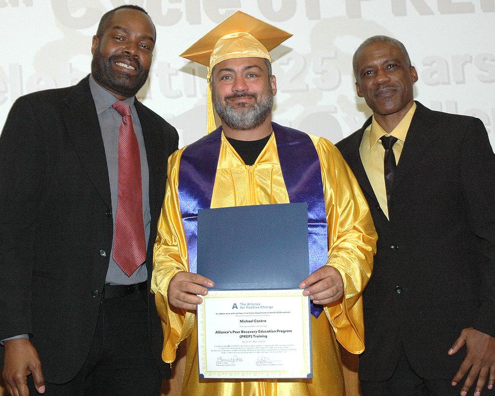 David P., Michael C. and Raheem K. with Michael's certificate