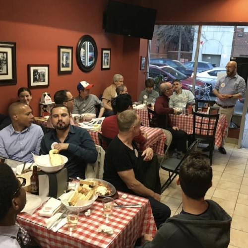 Diners gather for delicious pizza and pasta at Sac's Place of Jackson Heights in 2018