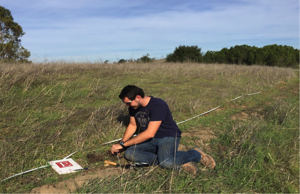 Stanford student, Nicholas Cody Mascarello, tests the soil moisture at Arastradero Preserve