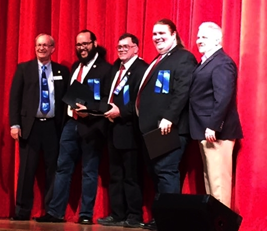 Harmonic Collective members receiving Songbird Awards. (L-R District Vice President David Bay, Tito Reyes, Gene Evans, Sagan Harris, District President Nathan Bell)