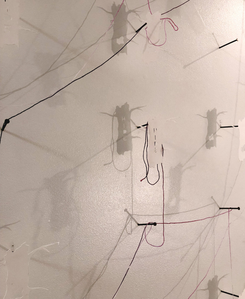 "Student: Hanna Kesty Class: Sculpture I Project: ""Form from Flat"" Cut paper, string, steel, projected image.  2018"