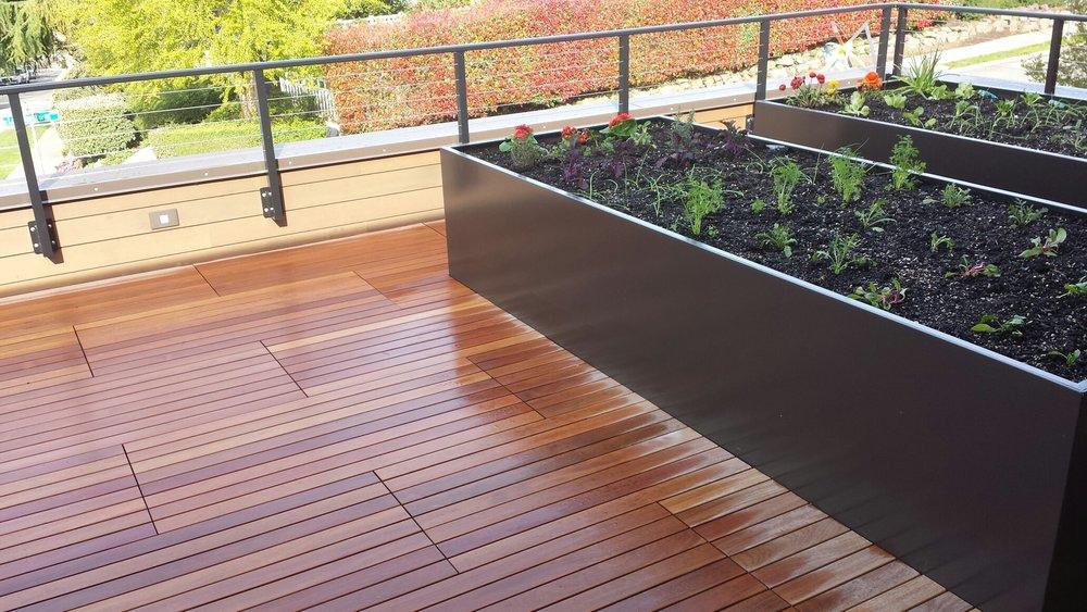 Rooftop veggie garden planters with Cumaru pavers.