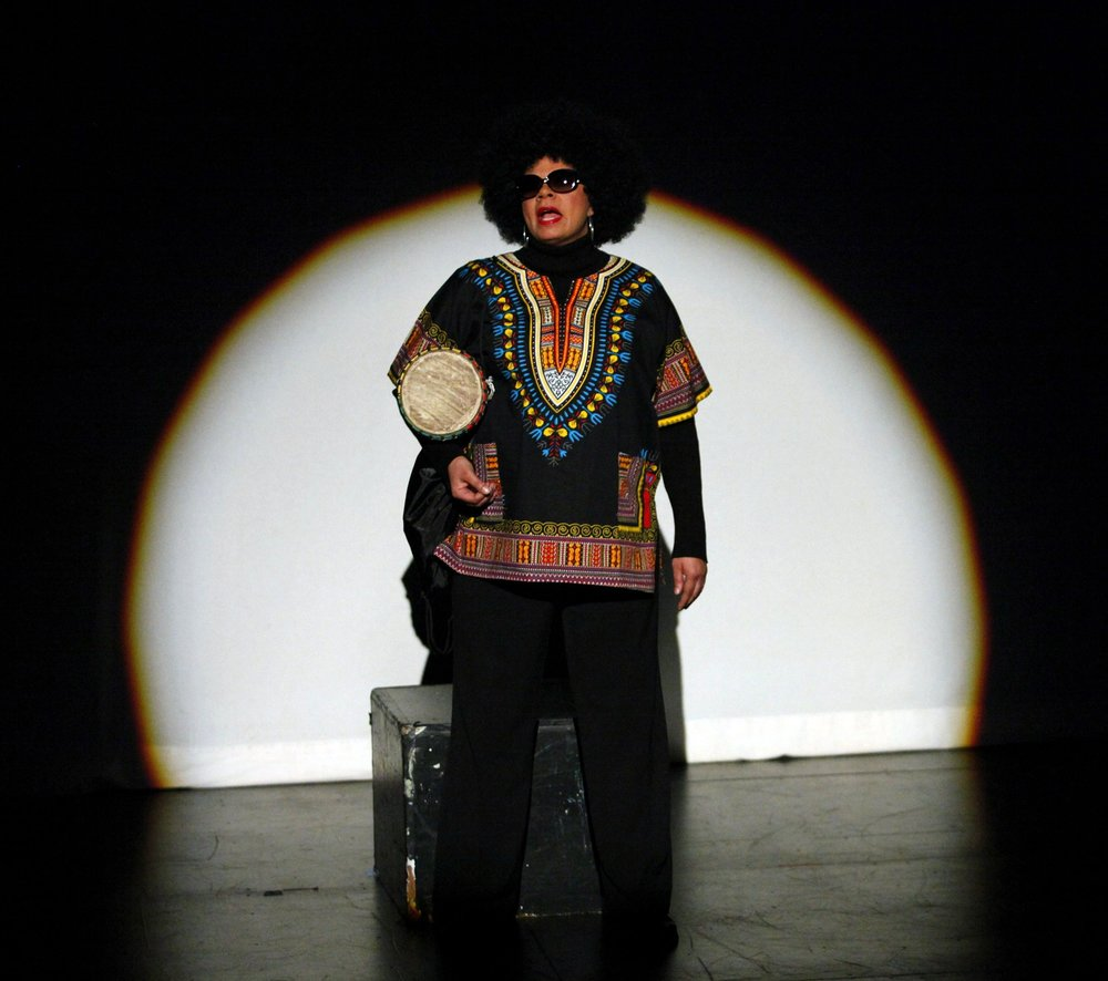 Yvette Heyliger performs an excerpt of  Bridge to Baraka  in Tribeca Performing Arts Center's Writer's in Performance (2011).    Photo Credit: Kena Betancur