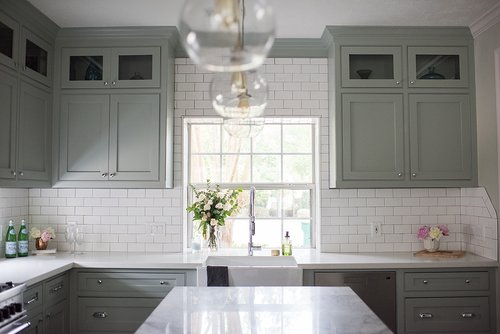 Cambridge Row: Super White Quartzite Kitchen Island. Photo by Melissa Parsons.