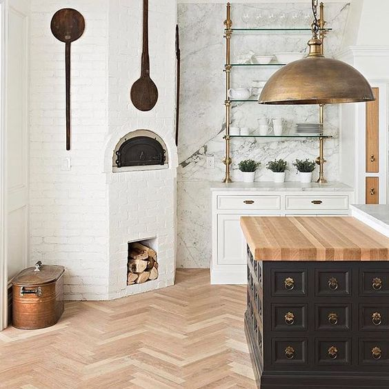 This is by The Fox Group. I love their work! As you can see, there's a butcher block on the side and the main island is marble.