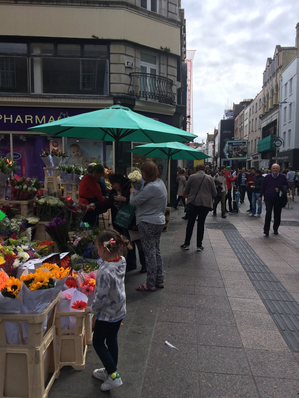 smelling-the-flowers-on-grafton-street-in-dublin.jpg