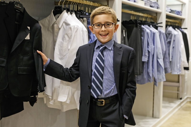 10-year-old Flynn shows off his dapper duds at Brooks Brothers. By Annie Wermiel
