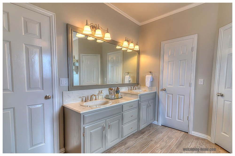 Painted cabinets, new fixtures, hardware, framed mirror, lighting, door added for privacy
