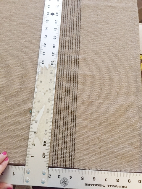 Straight line - I like to use a T square ruler so that everything lines up straight.  It's best to align the fabric's side that hasn't been cut against an edge of the table.  This way you have another straight edge along with your ruler's. You can buy a ruler like mine at homedepot