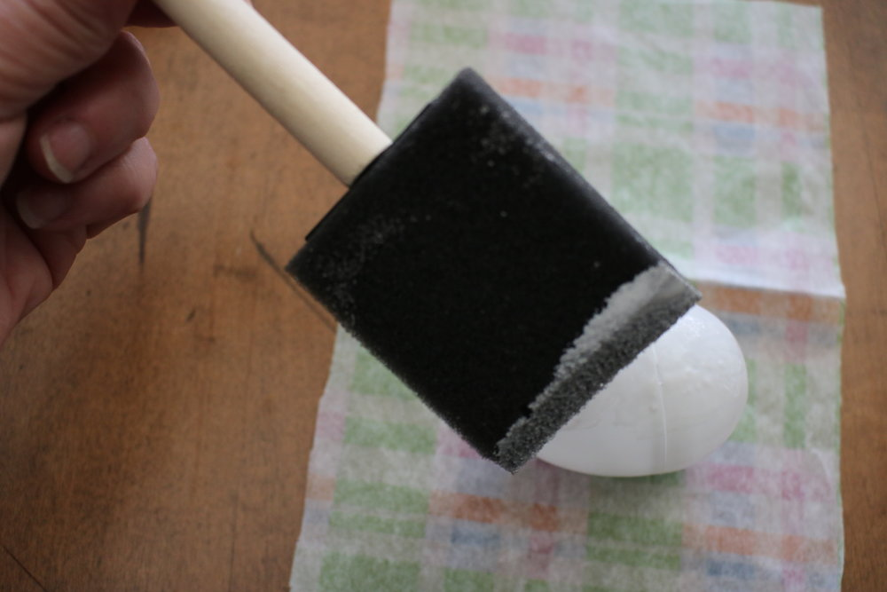 Step 3 - Spread the glue on one side of the egg