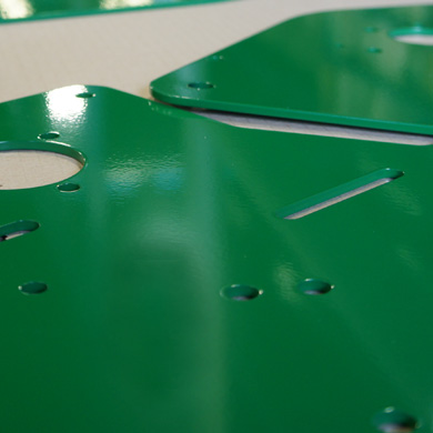 Green powder coated metal pieces