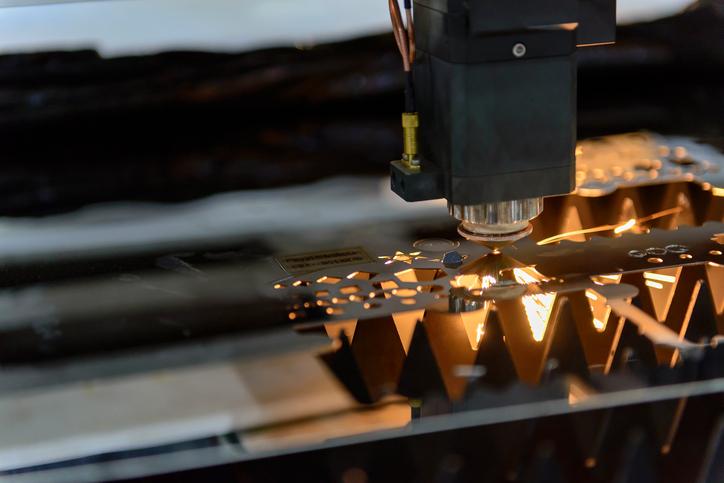 Laser cutting sheet metal for custom metal fabrication.