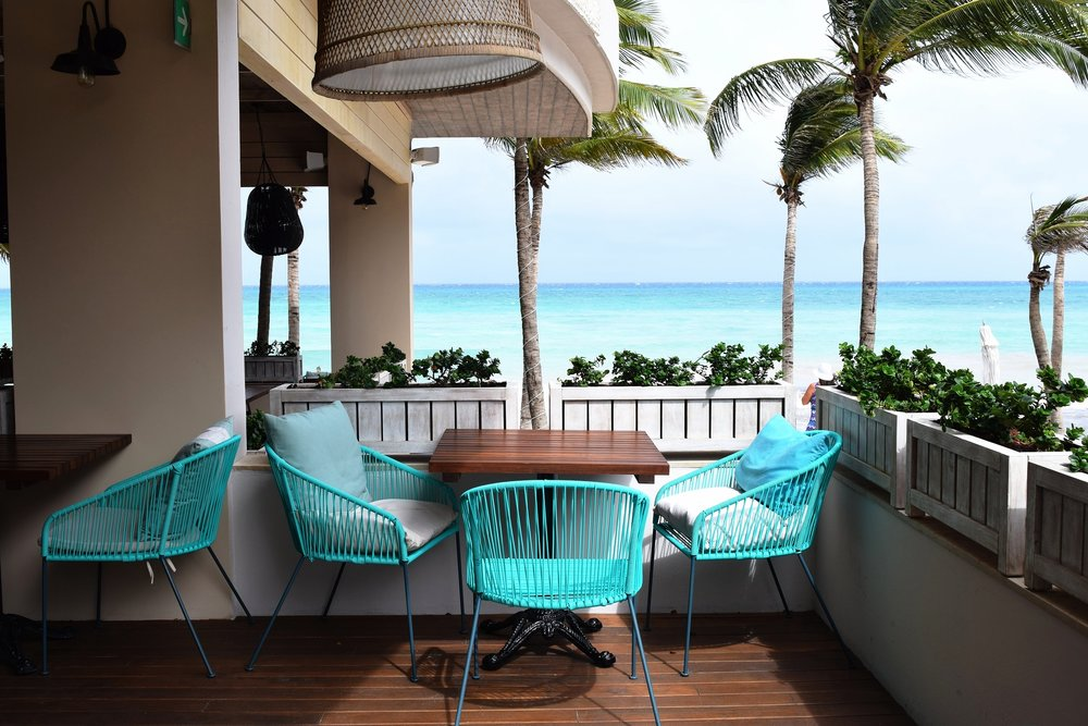 The chic Thompson Beach House sat feet away from the aqua blue waters.