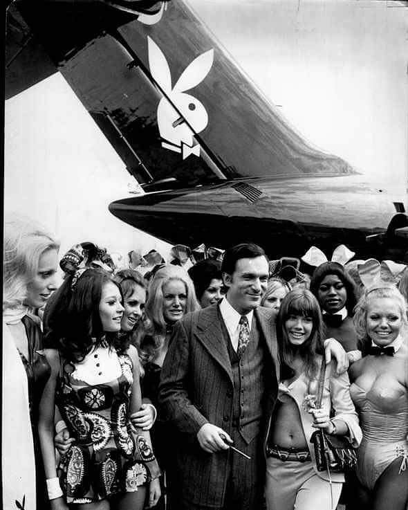 They say a picture is worth a thousand words. Hugh Hefner, dressed in a suit, surrounded by babes, with his private jet, with his logo painted on it, in the background.  RIP Hugh Hefner. You were a business, marketing and branding genius. May the angels in heaven be as beautiful as the ones you hung out with on Earth...