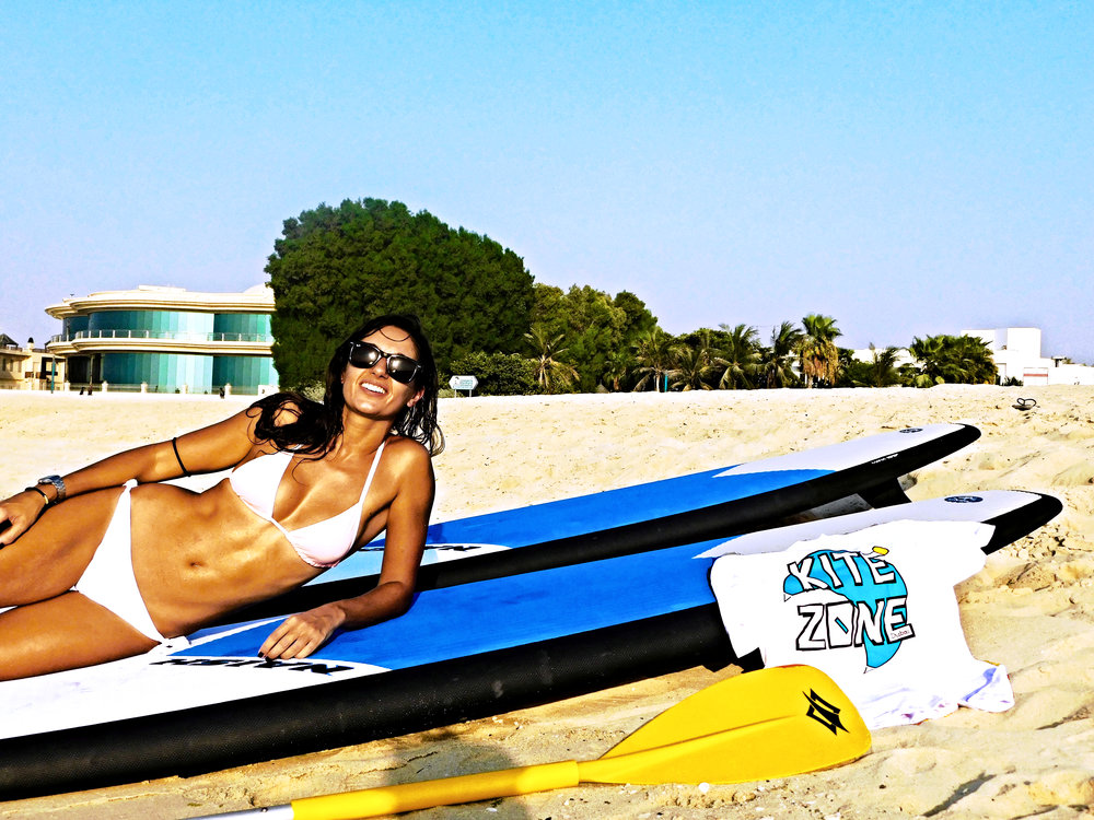 Dani shows off that toned body after a long session on the water