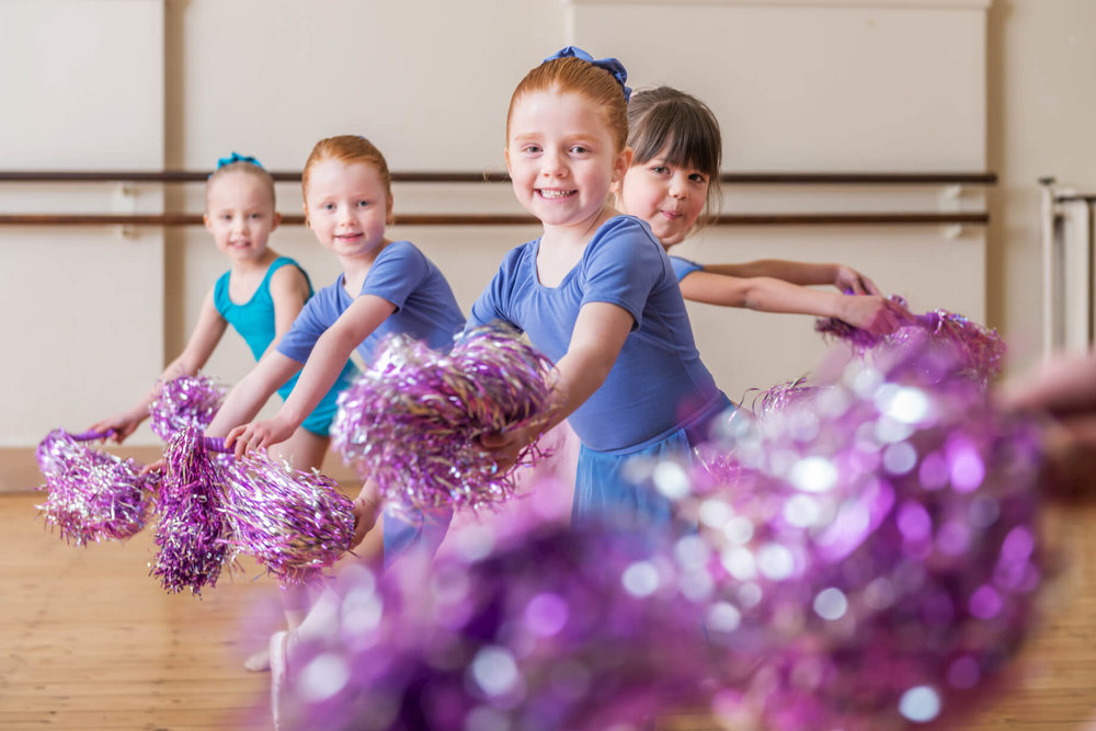 rnsd-rutleigh-norris-dance-school-young-girl-dancers-class-pom-poms-purple-blue.jpg