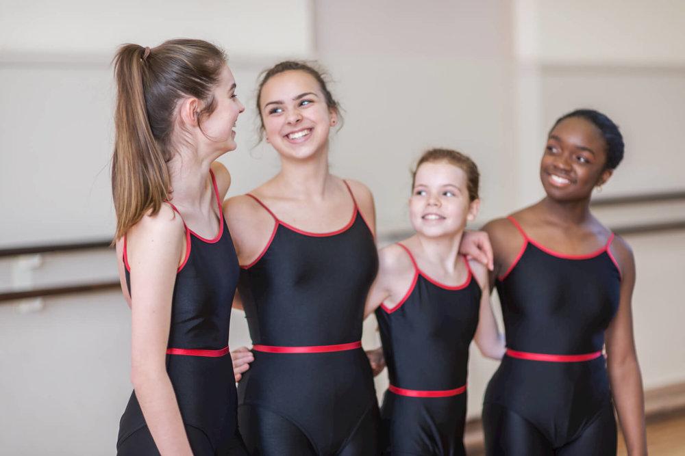 girls-smiling-modern-dance-class-rnsd-rutleigh-norris-school-of-dance.jpg