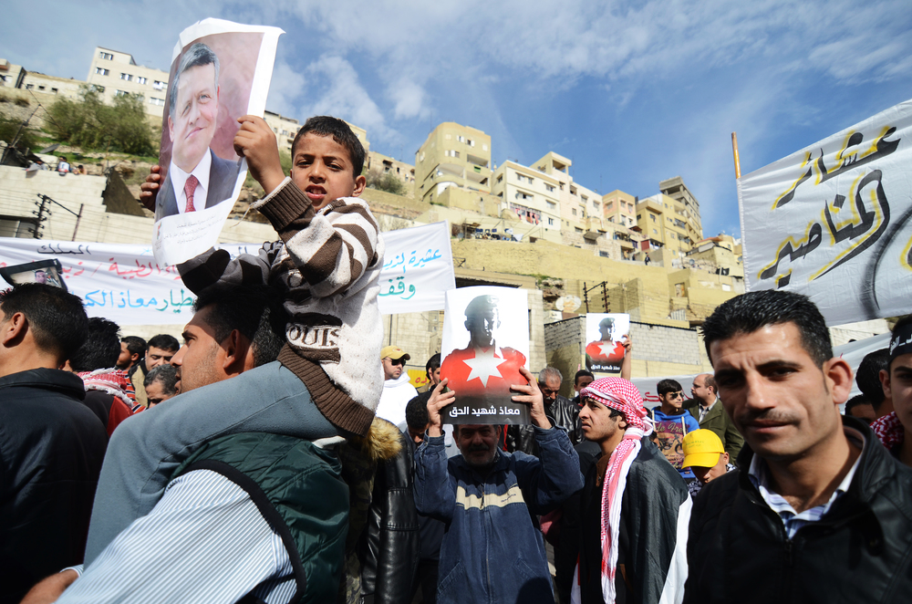 A Jordanian child holds a poster of Jordan's King Abdullah II during Amman's solidarity demonstration,one of the largest the country's seen in years.February 2015.