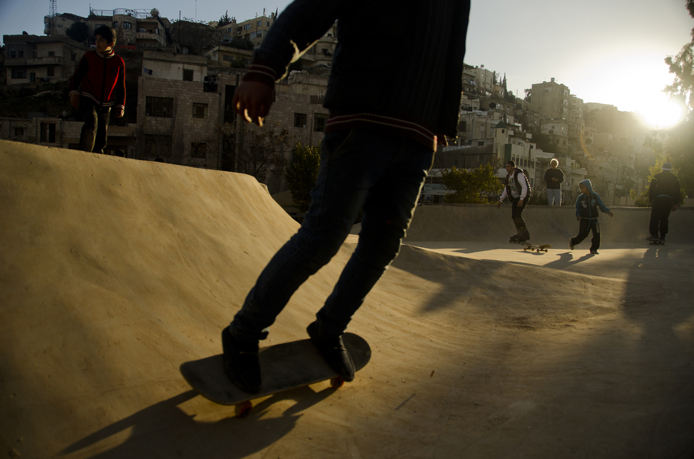 A young skateboarder rides across Jordan's first skate park, 7Hills, days after its inception in downtown Amman.  See the full story on Al Jazeera.  February 2014.