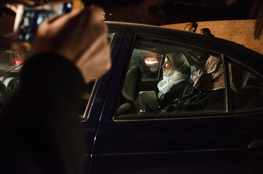 Jordanian pilot Muath Kasasbeh's wife and father load into their vehicle following a visit with King Abdullah II to discuss Jordan's attempted negotiations for the pilot's release from ISIS militants on January 28, 2015, just days before the release of a grisly video depicting the pilot's execution. January 2015.