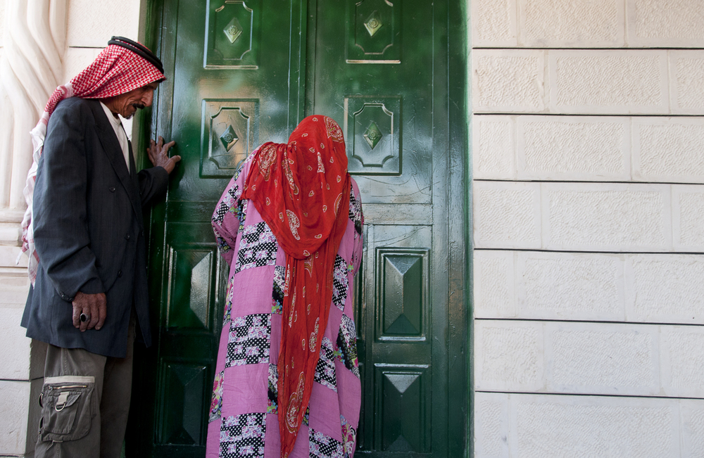Abu Husain and his wife enter their home in the outskirts of Amman.  While the Bani Murra are regarded as nomadic passersby by their fellow Jordanian countryman, tribal leaders claim historic ties to the country dating back to 1860. July 2013.