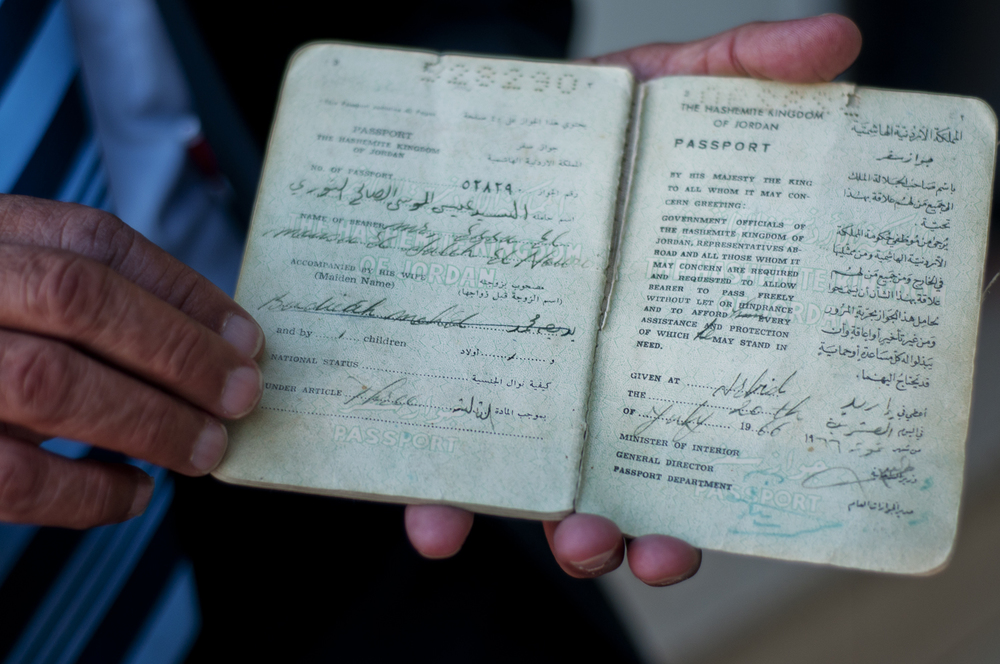Moussa displays his grandfather's Jordanian passport from 1960. Moussa uses the document to prove the Bani Murra's longevity in Jordan and loyalty to the country's ruling Hashemite family. He plans to present it to King Abdullah II to demand better tribal rights. July 2013.