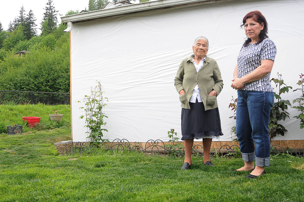 Louse and Esther pose outside their home in Burlington, Washington.  Though Louse has learned some from her mother, she says she's uncomfortable with continuing the practice on her own. October 2013.