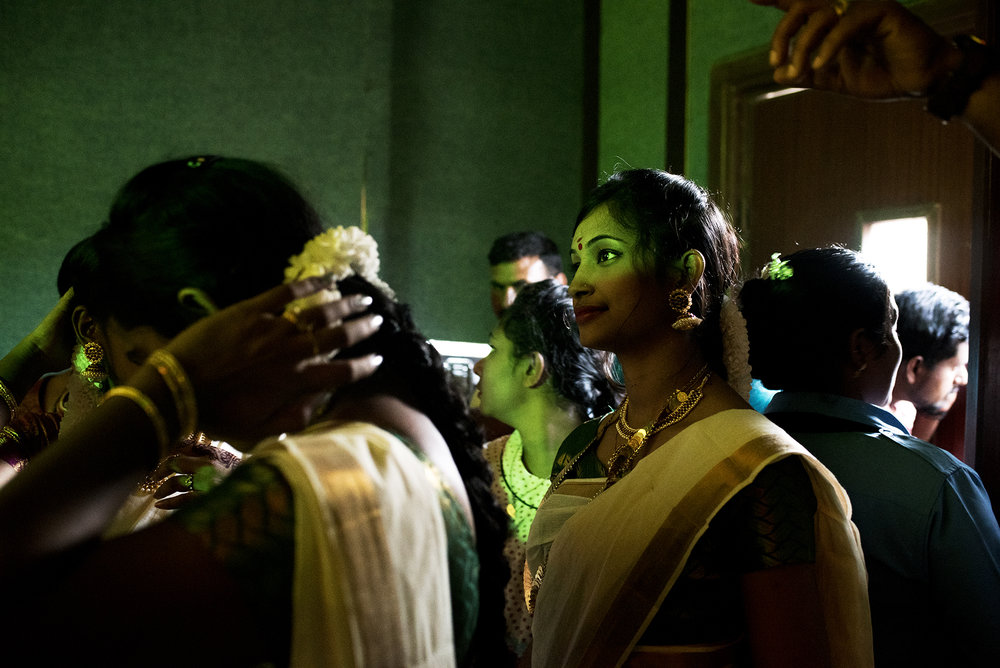 An Indian employee of Jordan's Classic Fashion Apparel Industry Ltd. Co. waits to perform a traditional dance during the an annual celebration of Onam, a southern Indian harvest holiday.