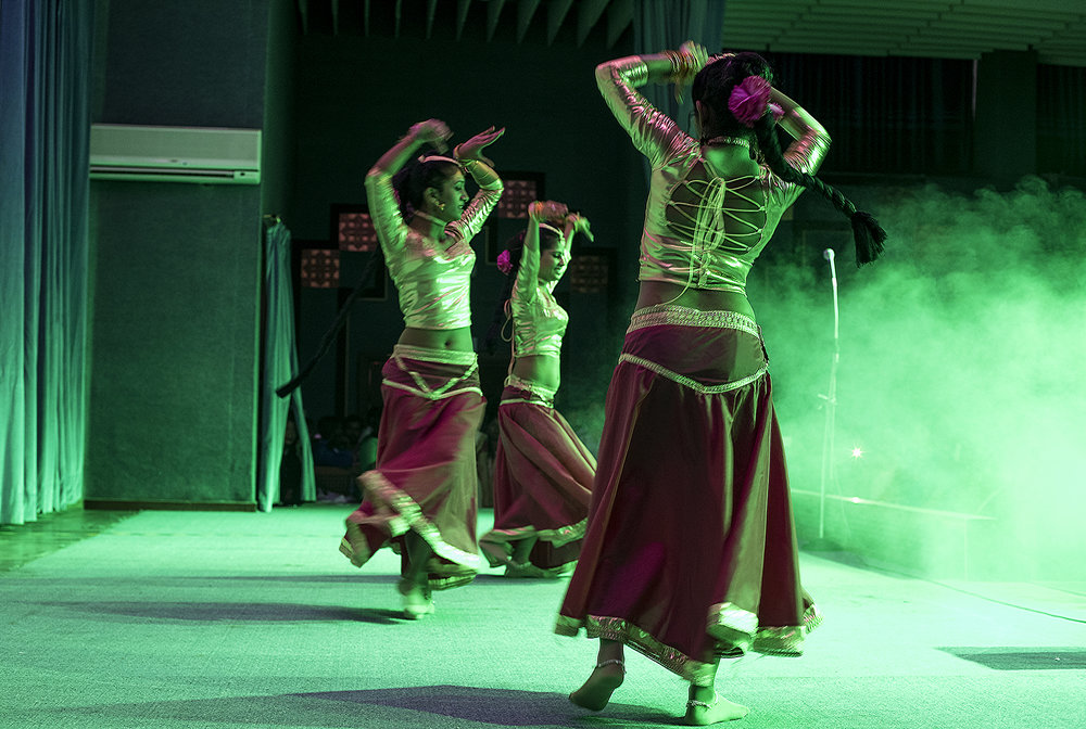 Sri Lankan workers perform a traditional dance.