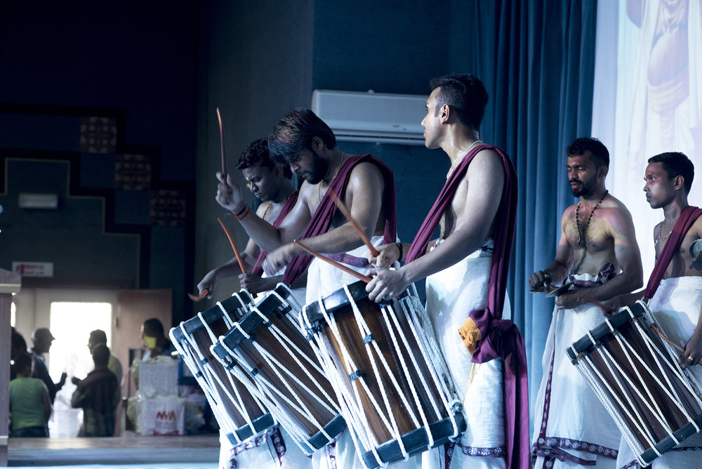 Indian workers perform a traditional drumming piece during the an evening showcase traditional dances and songs from migrants' home countries.