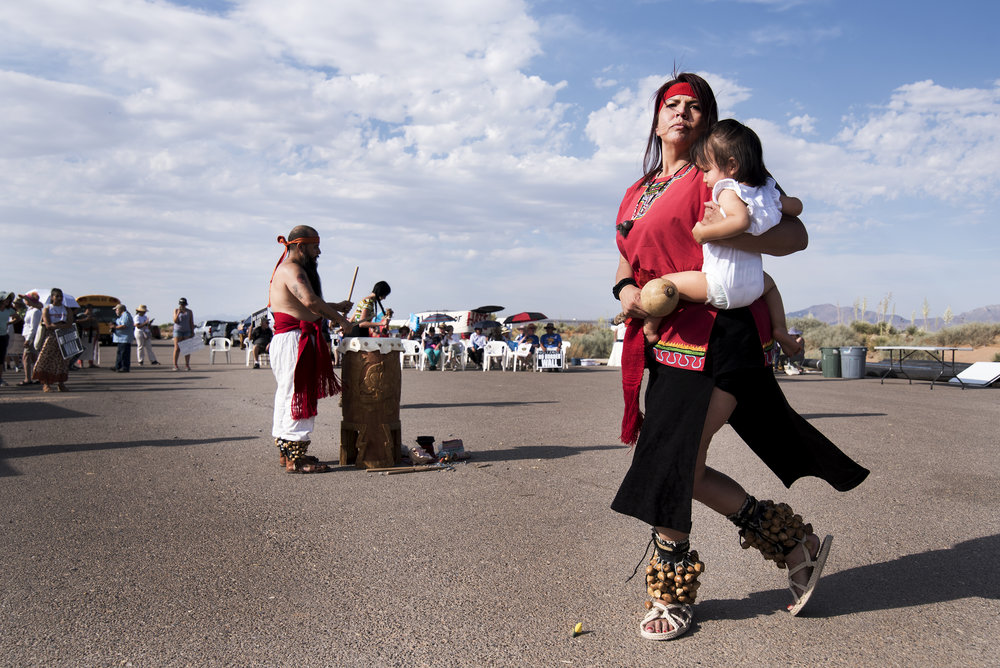 An Aztec performance group from El Paso, Texas performs a few paces from New Mexico's Santa Teresa Port of Entry during a demonstration against new border wall construction. June 2018.